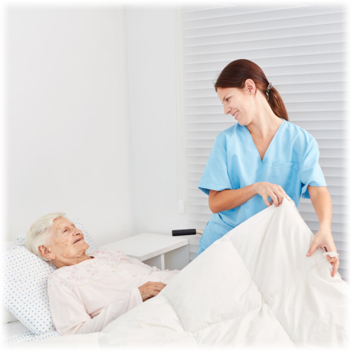 caregiver assisting elderly woman on lying in bed